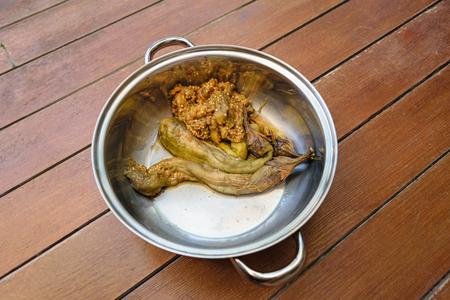 repast: Thai food pound eggplant in pot on wood table
