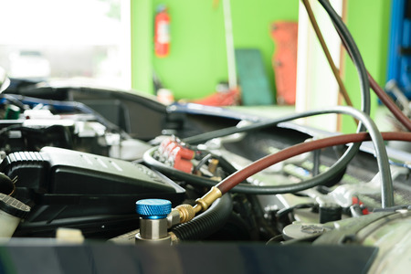 conditions: Car refilling air condition in air shop