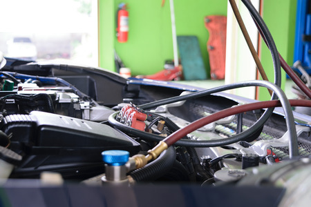 refilling: Car refilling air condition in air shop