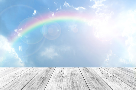 rainbow scene: Wood terrace and Blue sky and white cloud with rainbow Stock Photo