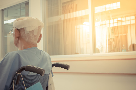 Patient elderly man with head injury on wheelchair in hospital, Vintage style