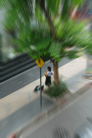 african sax: Blurred zoom of Young woman playing saxophone in the city streets Stock Photo