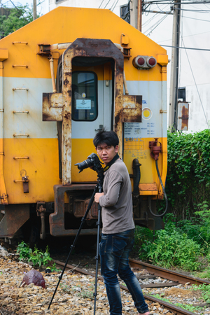 cheaper: Bangkok, Thailand - September 5, 2015 : Unidentified photographer train shooting. Many people in Thailand popular travel by train because it is cheaper.
