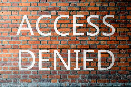 access denied: Red Brick wall texture background with a word Access Denied Stock Photo