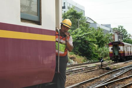 switching: Bangkok, Thailand - September 5, 2015 : Unidentified railway employees controlling the locomotive for switching the railway before serving at State Railway of Thailand.