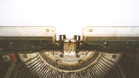 hoja en blanco: Vintage typewriter and a empty white paper , process in vintage style Foto de archivo