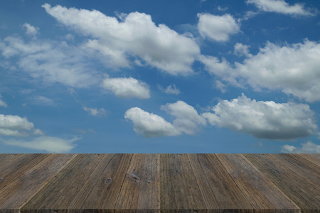 porch scene: Wood terrace and Blue sky with white cloud background