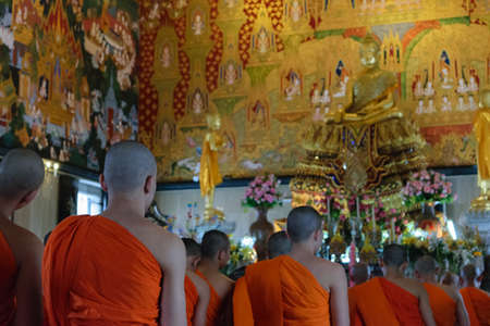 thai monk: Bangkok, Thailand - August 29, 2015 : Thai monk worship in temple at Wat Hua Lamphong. Wat Hua Lamphong is a Royal Buddhist temple, third class, in the Bang Rak District of Bangkok, Thailand.