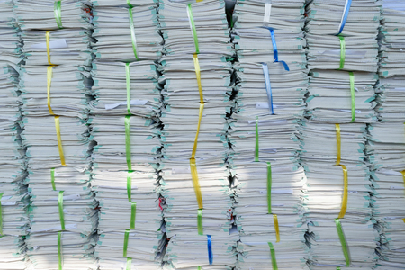 Old files stacking up in a messy order. Stock Photo