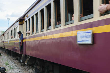 cheaper: Bangkok, Thailand - September 5, 2015 : People on the Thai train. Many people in Thailand popular travel by train because it is cheaper.