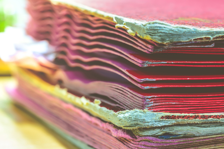 disorganization: Files in old folder stacking up in a messy order. , process in vintage style Stock Photo