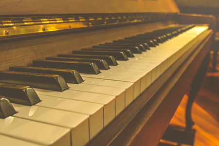 warm color: Piano keys in warm color tone , process in vintage style