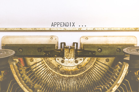 appendix: Vintage typewriter and a empty white paper with a word Appendix , process in vintage style Stock Photo