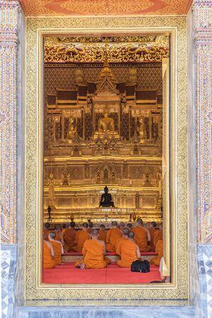 thai monk: Bangkok, Thailand - September 5, 2015 : Thai monk worship in temple at Wat Thep Sirin Thrawat Ratchaworawihan.