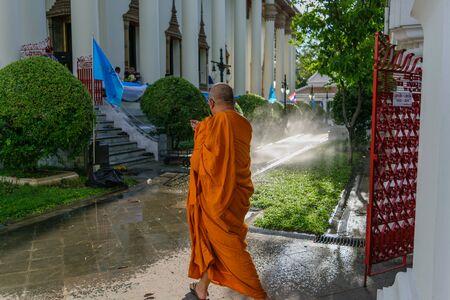 thai monk: Bangkok, Thailand - September 5, 2015 : Thai monk walking in temple to worship in Wat Thep Sirin Thrawat Ratchaworawihan. Editorial