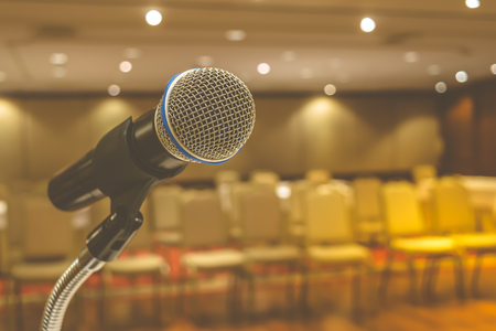 Microphone in seminar event defocus on meeting room background , process in vintage style