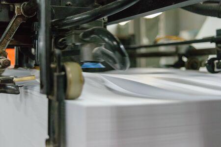 printery: Sheet offset machine draws paper in printery