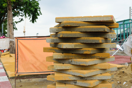 paver: Worker laying paver bricks paver making sidewalk Stock Photo