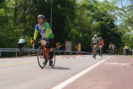 split road: Chanthaburi, Thailand - May 31, 2015 : Cycling competition in Two Wheels In Love MTB and Road bikes, split into various age groups on the scenic route Chalerm-Burapa-Chollathit Rd. Editorial