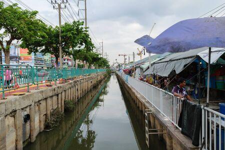 rd: Bangkok, Thailand - September 11, 2015 : The polluted canal near market at Srongprapha Rd. Sikan, Don Mueang