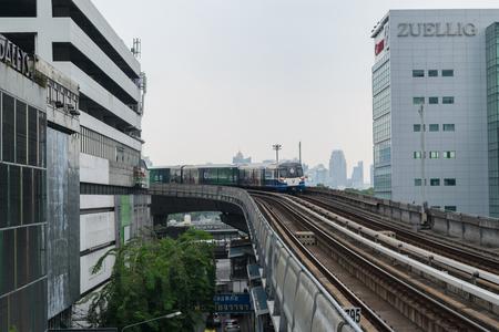 silom: Bangkok, Thailand - March 28, 2015 : A BTS Skytrain runs through the Silom Station. The Silom Line is a route of the BTS Skytrain in Bangkok.