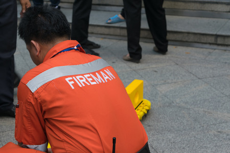 preparedness: Bangkok, Thailand - November 20, 2015 : Many working people preparedness for fire drill or other disaster at office in Bangkok Thailand