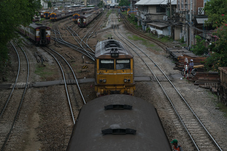 cheaper: Bangkok, Thailand - September 5, 2015 : Unidentified railway train run on the railroad tracks. Many people in Thailand popular travel by train because it is cheaper. Editorial