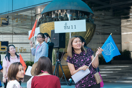 hazardous material team: Bangkok, Thailand - November 20, 2015 : Many working people preparedness for fire drill or other disaster at office in Bangkok Thailand
