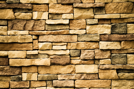 Stone wall texture background surface natural color , process in vintage style