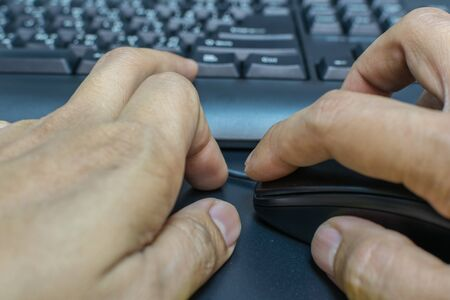 use computer: Human hand use computer with mouse and keyboard