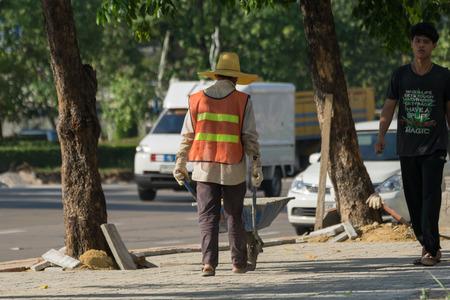 paver: Bangkok, Thailand - November 21, 2015 : Unidentified worker laying paver bricks paver making sidewalk Editorial