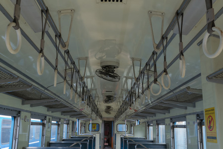 handrails: Cabin of a Public Thai Train Railway with handrails. This is a public train Does not require a property release. Stock Photo