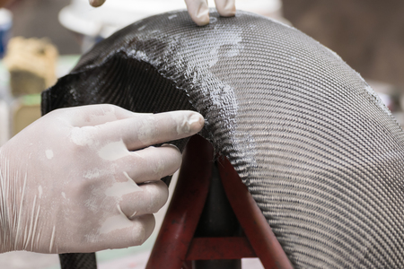 Wrapping carbon fiber or kevlar and man hand for working