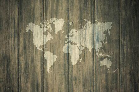 mapa de procesos: el uso del color natural de la superficie de textura de madera para el fondo, proceso en el estilo de la vendimia con el mapa del mundo