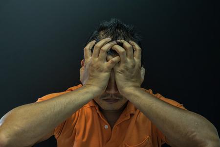 Asian short hair man feeling sadness and stress, Dark dramatic style