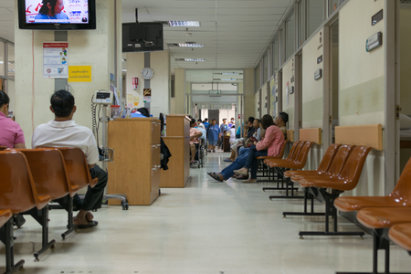 Bangkok, Thailand - February 2, 2016 : Unidentified patient waiting a doctor and nurse in unidentified hospital.