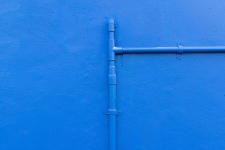 Minimalism style, Blue water pipe on blue wall texture background. Stock Photo - 52919156