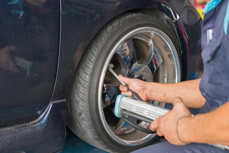 disassembly: Checking suspension and tire pressure in a car by tool electronic tools at  car garage