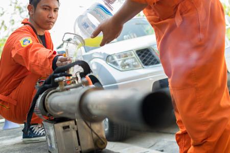 aedes: Bangkok, Thailand - January 31, 2016 : Unidentified people fogging DDT spray kill mosquito for control Malaria, Encephalitis, Dengue and Zika in village at Bangkok Thailand. Editorial