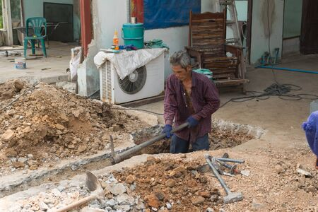 Bangkok, Thailand - February 20, 2016 : Unidentified worker dig a floor for build a home.