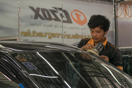 buffing: Bangkok, Thailand - December 12, 2015 : Unidentified car care staff cleaning the car. Editorial