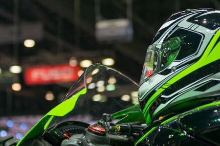 credentials: Zoom at motorcycle helmet in Car show event at Bangkok, Thailand. This a open event no need press credentials required.