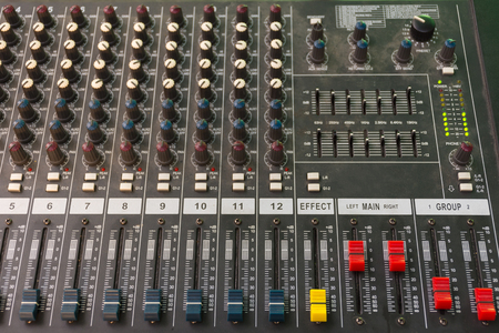 Sound mixer control board with volume buttons. Stock Photo