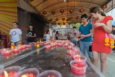 lengnoeiyi: Bangkok, Thailand - March 6, 2016 : Thai people pray in temple at Wat Mangkon Kamalawat (Wat Leng Noei Yi). Wat Leng Noei Yi is the most important Chinese Buddhist temple in Bangkok, Thailand.