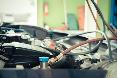 refilling: Car refilling air condition in air shop , process in vintage style