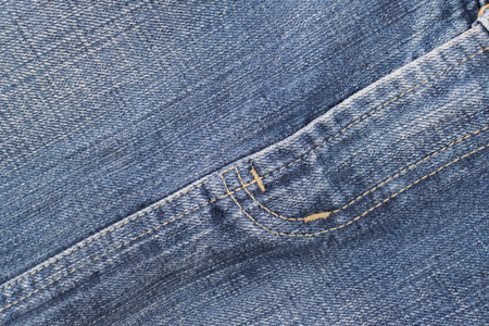 crotch: Detail of blue jeans crotch with yellow stitch