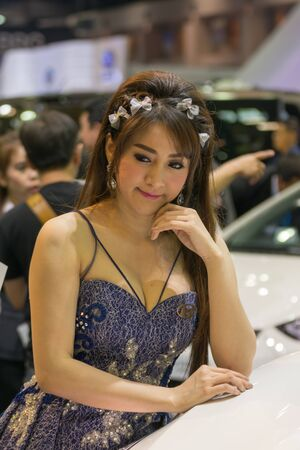 credentials: Bangkok, Thailand - December 10, 2015 : Unidentified model pretty lady on display in car show event. This a open event no need press credentials required.
