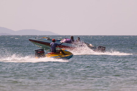 jetski: Rayong, Thailand - December 31, 2015 : Jetski or scooter boat is popular for people travel at LaemMaePhim. LaemMaePhim is a beach and sea without large waves, the beach is nice for swimming.