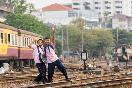 cheaper: Bangkok, Thailand - February 2, 2016 : Unidentified railway train on the railroad tracks in Bangkok station. Many people in Thailand popular travel by train because it is cheaper.