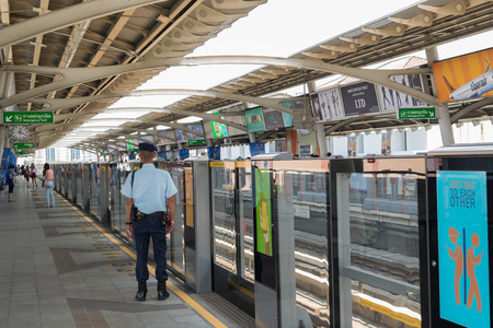 save time: Bangkok, Thailand - March 15, 2016 : Unidentified security guard on BTS skytrain train runs in Bangkok. Many people in Bangkok used skytrain to save time.